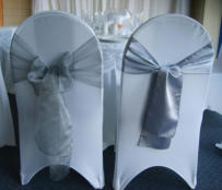 One style of chair cover with example silver Organza and Satin sashes