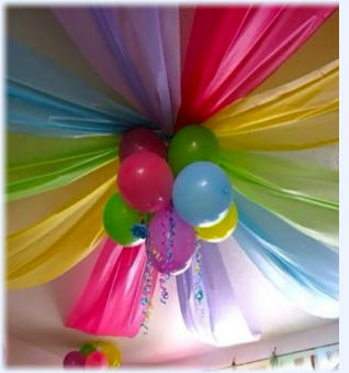 Wonderful atmosphere created by colourful roof drapes and balloons